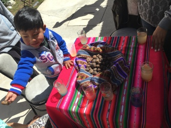 Lunch was Chuño (dehydrated potatoes) and limeade and a beautiful soup made with fish. Victor was so happy to share the food with us, here he is feeding Gabriella Chuño